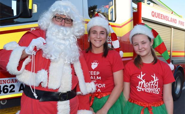 Santa and his helpers arrive at the Kingaroy Christmas Carnival