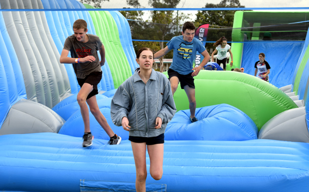 Racing on the inflatable obstacle course at last year's inaugural Murgon Rail Trail Festival
