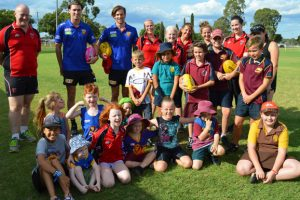 Young Saints Celebrate Visiting Lions