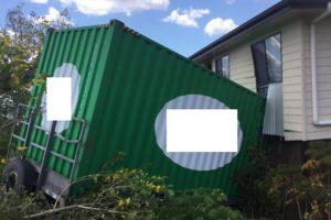 Trailer Crashes Into House